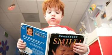 for Travel - 12childcare - Bradley Snyder, 18 months, of Park City flips through a book at The Canyon�s daycare facility in Park City, Utah, called Little Adventures Children�s Center, which welcomes kids 6 weeks to 6 years of age. (Kari Bodnarchuk for the Boston Globe)